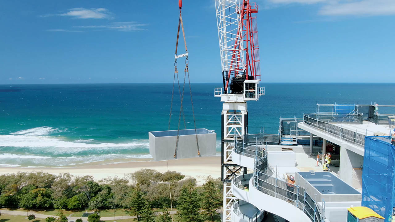 Two 4.6m x 2.5m concrete plunge pools being lifted onto a 17 story development on the Gold Coast